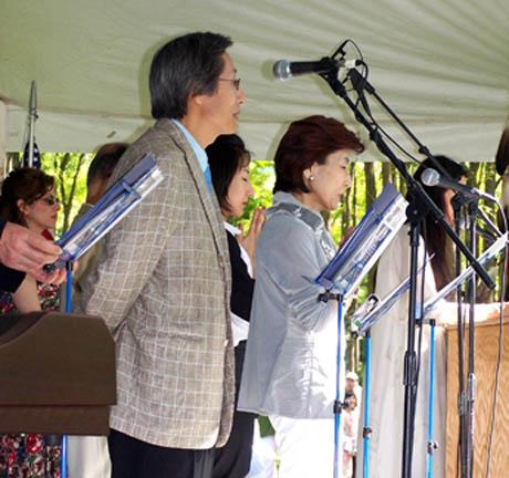 The Saionji's pray during The World Peace Prayer and Flag Ceremony.