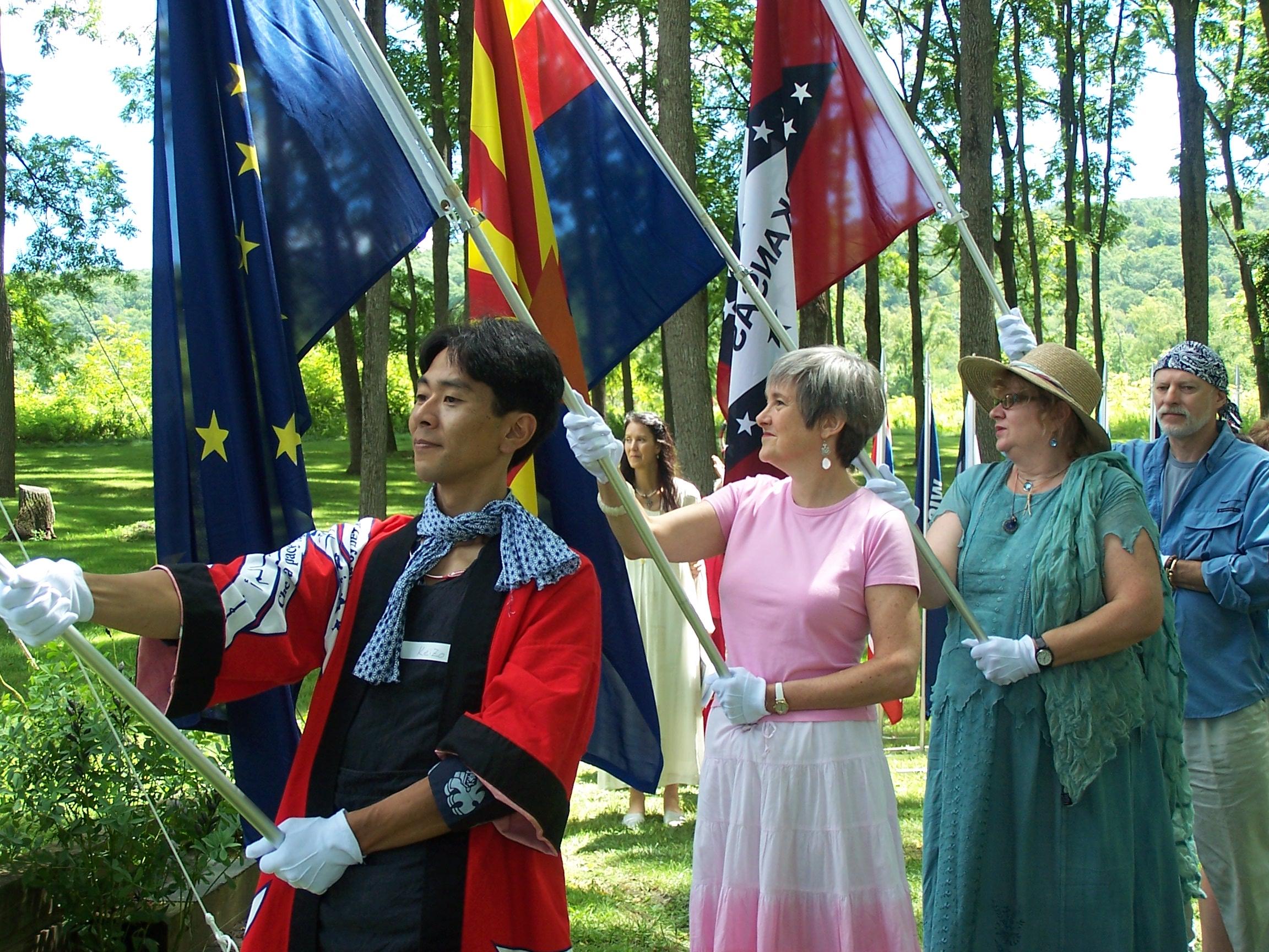 Keizo Aoi, Deborah Moldow and Tonia Shoumatoff participate in the United States of America Flag Ceremony.