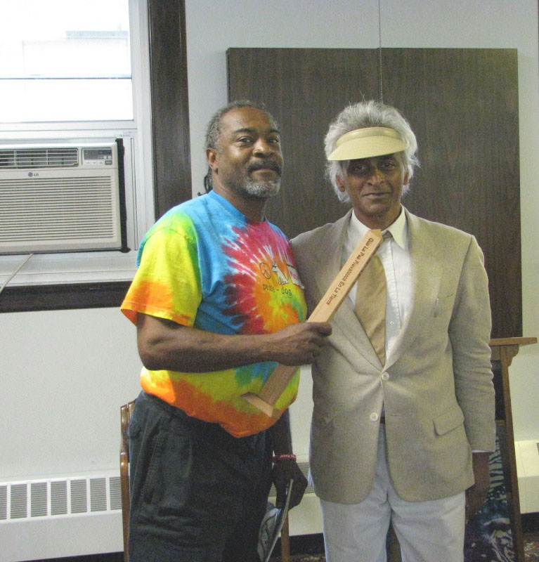June-2008 Peace Representative, of The World Peace Prayer Society, Melvin Giles presents a desktop Peace Pole to Dr. Gangadeen at the Creating a Compassionate Democracy Conference.