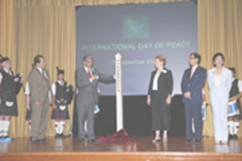 "Introduction of the ""Peace Pole"", which carved on one side in Chinese ""May Peace Prevail in Hong Kong"", by (from left) Professor Lap-Chee Tsui (Vice-Chancellor, HKU), His Excellency Mr Khalid Malik (UN Resident Coordinator – China), Mrs Malik, Dr Albert Wong (District Governor of Rotary International District 3450) and Ms Maria Ying-Matthews (Founder, Peace International Foundation)."