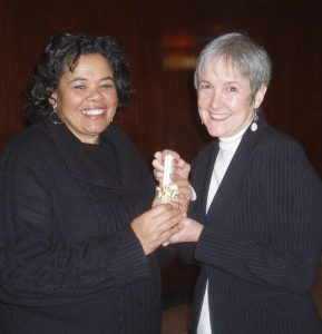 Audri Scott receives mini Peace Pole from Deborah Moldow