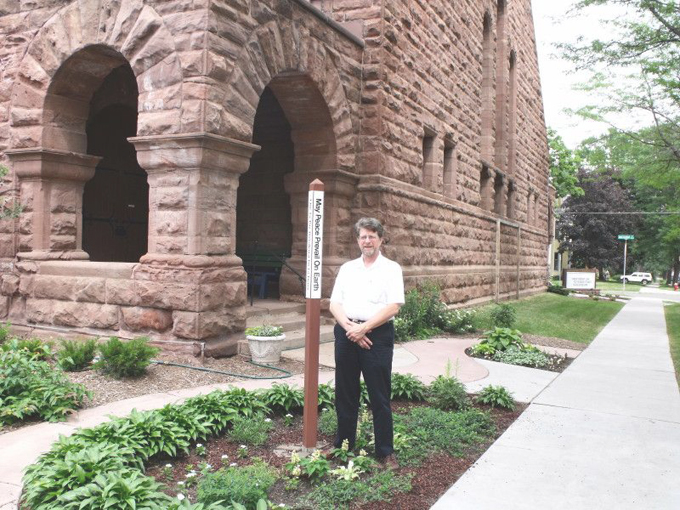 Photograph of Pastor David by the Dayton Avenue Presbyterian Church Peace Pole.