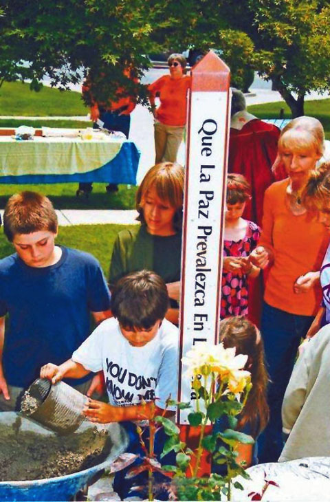 Students dedicate a Peace Pole in Grass Valley at the United Methodist Church. The local chapter of Grandmothers for Peace is raising money and exploring locations to erect a similar pole in Nevada City.