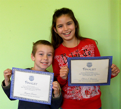 Boyan Ganev (left) age 5 and Elitca Ganeva (right) age 10 both Finalist from Bulgaria