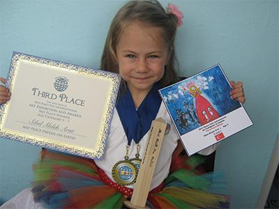 Sibel Melek Arat - Age 5 from Turkey - Third Place