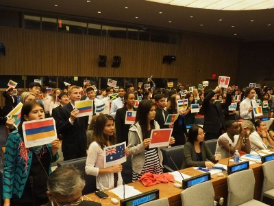 Students with UN Member Paper Flags