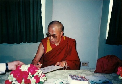 His Holiness the Dalai Lama signing May Peace Prevail On Earth, 1989