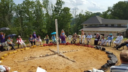 Rev. Laura George begins Peace Pole Ceremony
