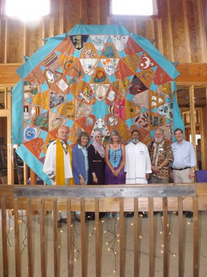 Pictured with the Peace Quilt (left to right): His Excellency Reverend Patrick McCollum, Ruth Broyde Sharone, Dina Shehata, M.A., Reverend Laura George, J.D., Guruji Sri Yogacharya Arun Kumarji, Glen T. Martin, Ph.D., and Reverend Don Lanksy