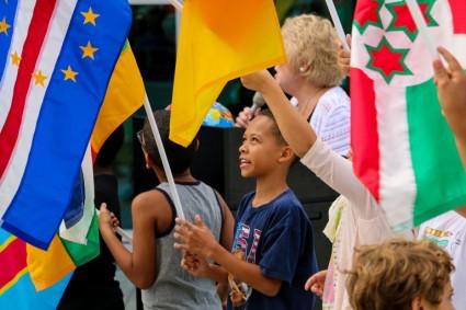 students-raise-flags