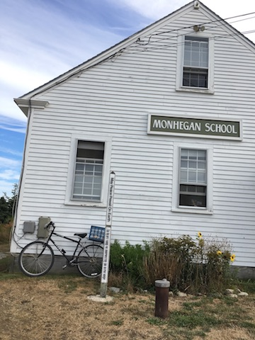 Schoolhouse Peace Pole on Monhegan Island, Maine, USA