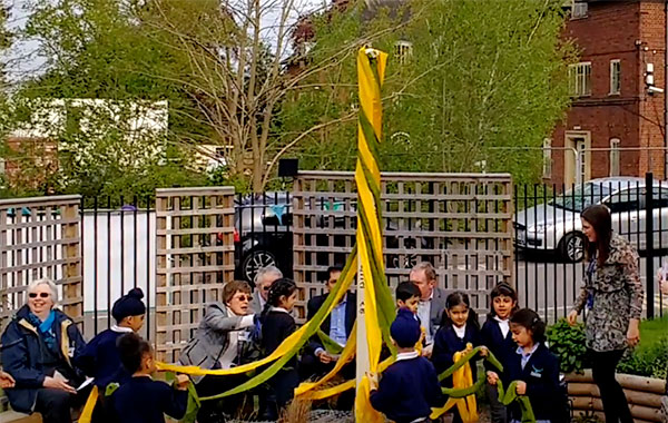 Pupils unwrap the Peace Pole at Falcons Primary School in Leicester