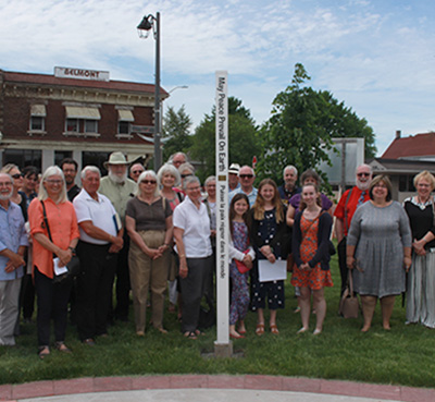 A Peace Pole Brings Together a Community with The Angelican Church of St. James and St. Brendan in Port Colborne, Ontario, Canada.