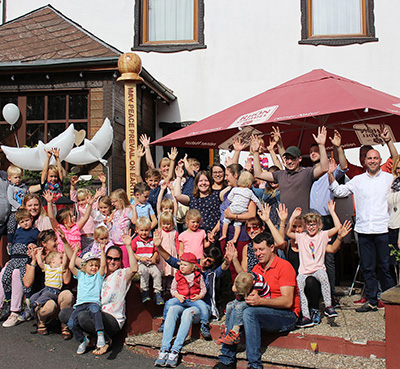 Rhönquelle Restaurant Sponsors Kindergarten to Create Peace Pole. Gersfeld, Germany