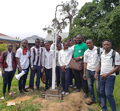 Peace Pole Planted at Secondary School OISHA City, Democratic Republic of Congo